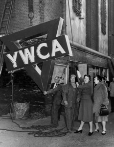 Vintage Image of YWCA lifting YWCA of New York City Sign on Side of Building