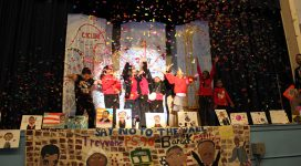 Out of School Time program students celebrate onstage after their Poetry Slam Performance.